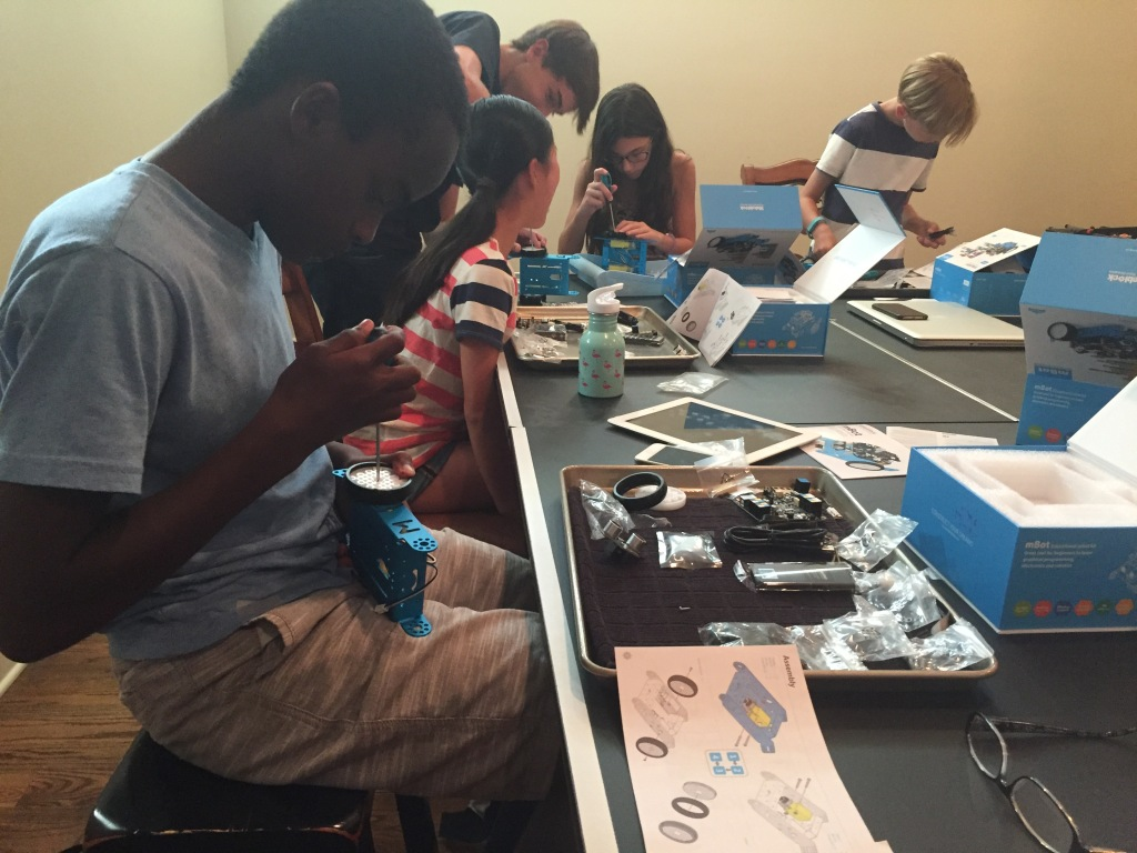 students work on building robot